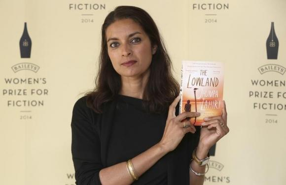"Author Jhumpa Lahiri poses with her novel ""The Lowland"", ahead of the 2014 Bailey's Women's Prize for Fiction in London"